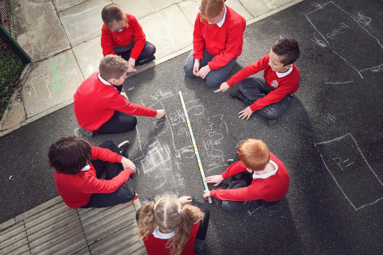 Half Acres pupils using chalk